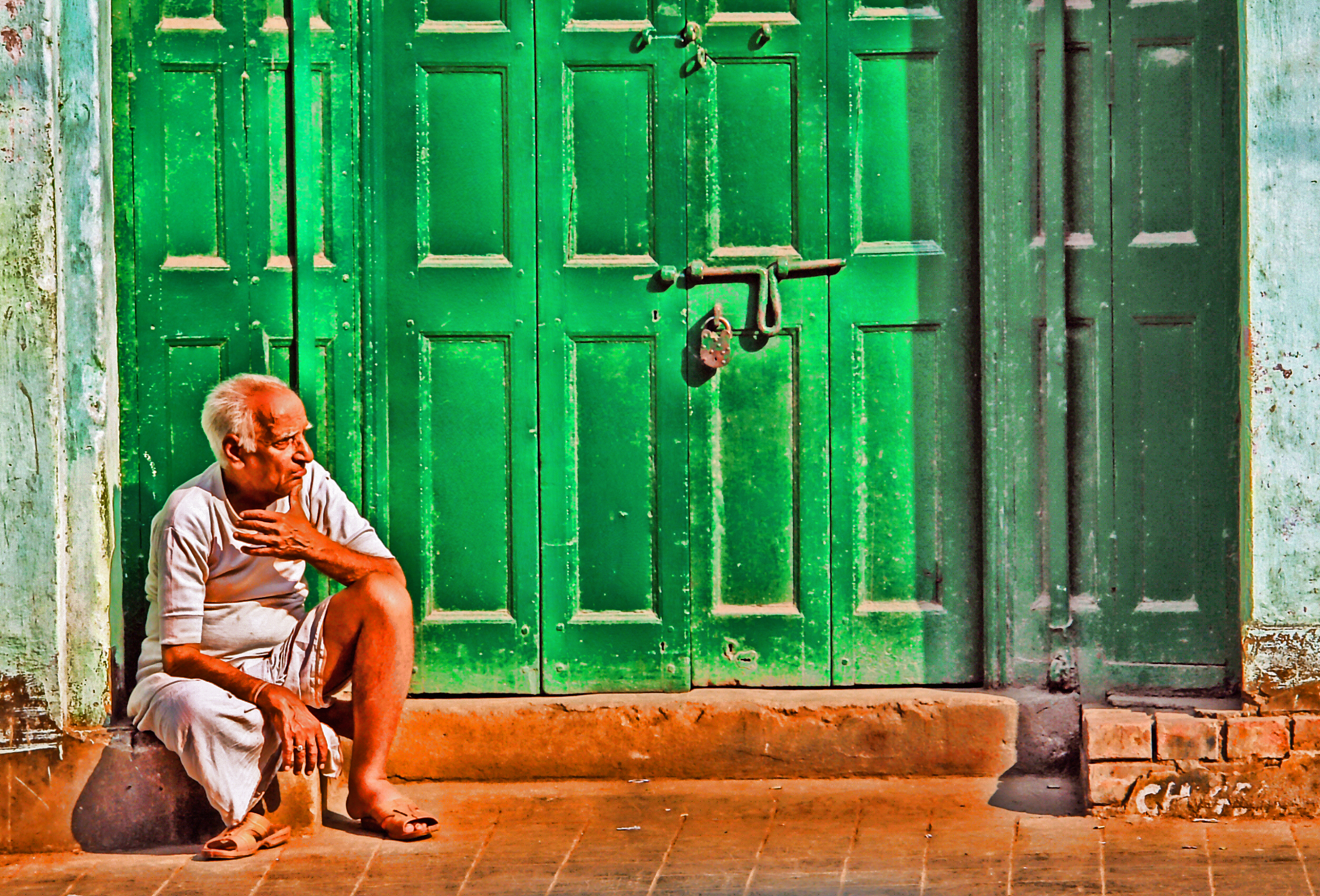 green door and old man in white